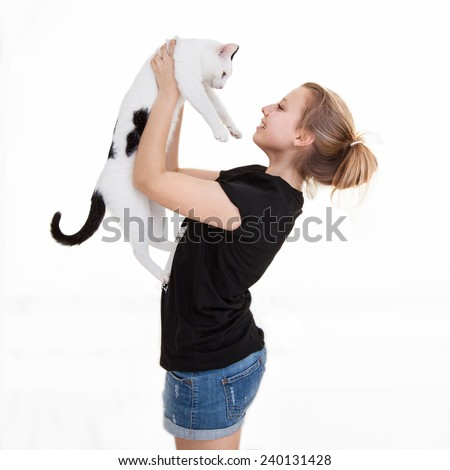 Young beautiful smiling teenager girl with a cat - stock photo