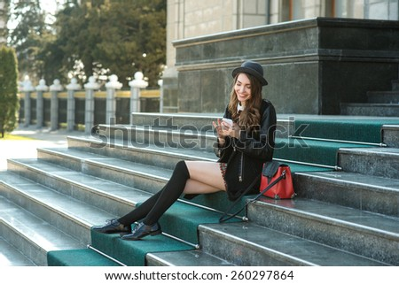 Young beautiful smiling woman talking on cell phone. Facial expression. Emotion. - stock photo