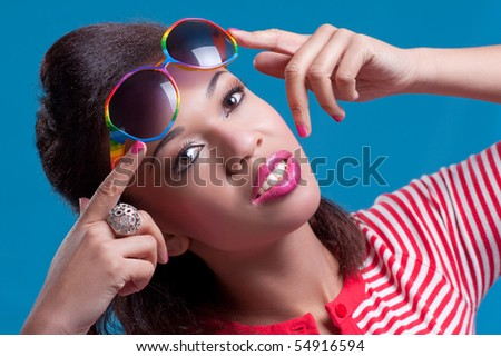 Young beautiful smiling woman wearing vintage sunglasses