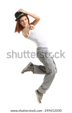 Young beautiful sports woman dancing on a white background. Modern dances. - stock photo