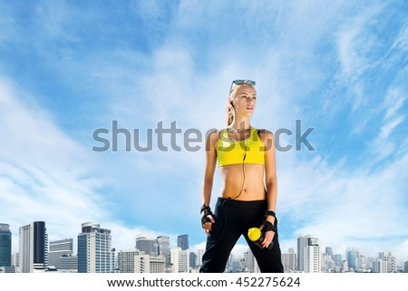 Young, beautiful, sporty and fit girl over city background