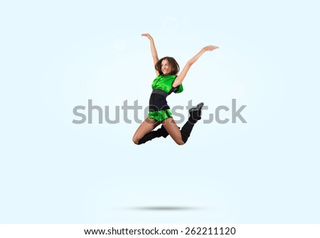 Young beautiful sporty cheerleader girl jumping high - stock photo