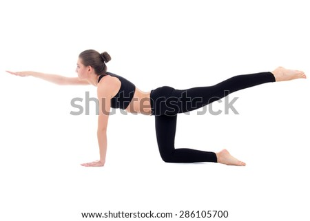 young beautiful sporty woman doing stretching exercise isolated on white background