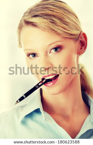 Young beautiful student girl with pen - stock photo