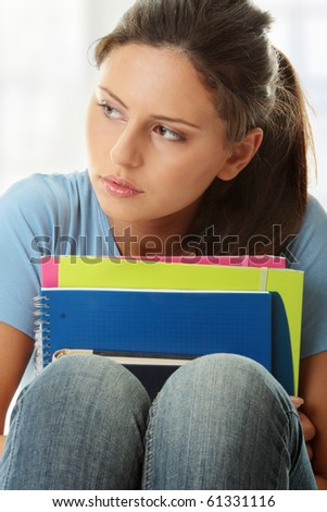 Young beautiful student woman with depression - stock photo