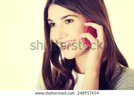 Young beautiful student woman with phone.  - stock photo