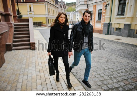 Young beautiful stylish couple walking of the street