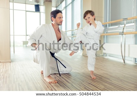 young, beautiful, successful multi ethical kids in karate positi