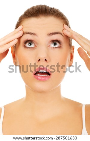 Young beautiful surprised caucasian woman. - stock photo