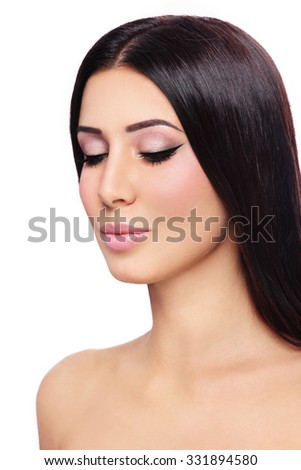 Young beautiful tanned brunette with winged eyes over white background, copy space - stock photo