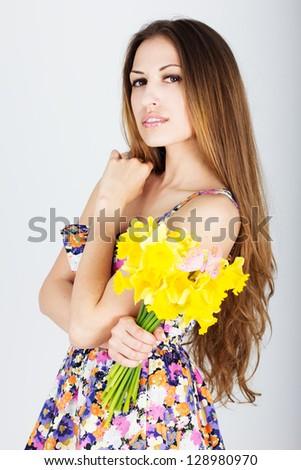 young beautiful teen girl with daffodils - stock photo