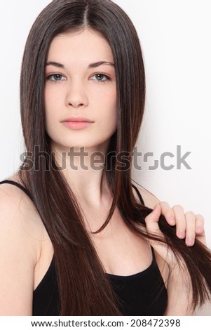 Young beautiful teen girl with long healthy hair and clean make-up - stock photo