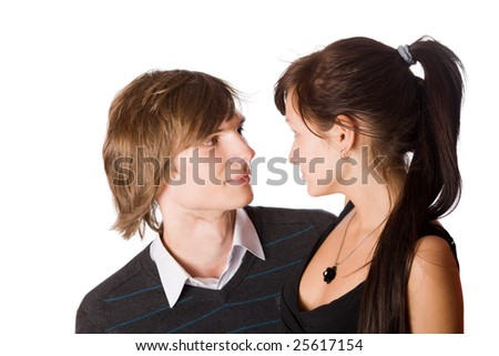 Young beautiful teenage couple sharing a secret isolated - stock photo