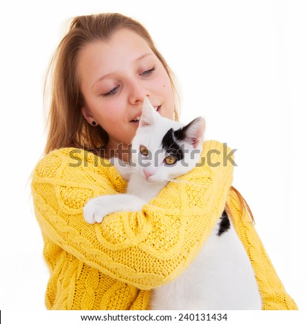 Young beautiful teenager girl with a cat - stock photo