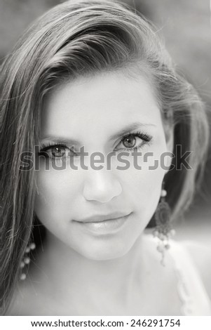 Young beautiful tender woman. Lovely sensual girl fashion outdoor portrait. - stock photo