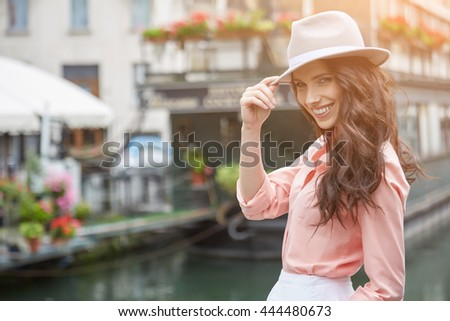 young beautiful tourist woman straight hair woman in the city - relax concepts