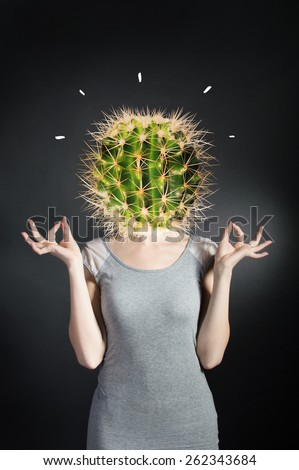 Young beautiful unhappy tired stressed overworked exhausted woman with green cactus head on black background. Job entrepreneur. Negative facial - stock photo