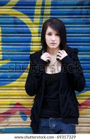 Young beautiful urban girl in pensive gesture - stock photo