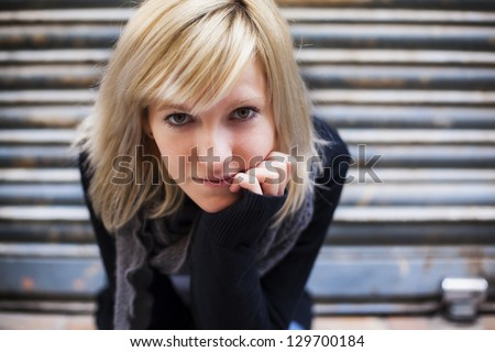 Young beautiful urban girl staring at camera with interest. - stock photo