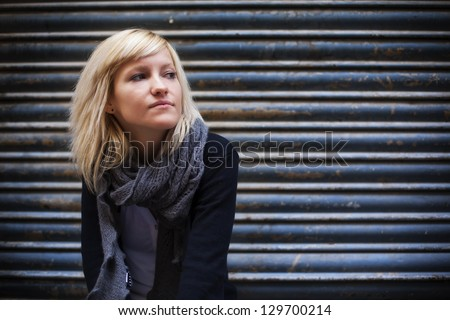 Young beautiful urban girl staring copy space. - stock photo