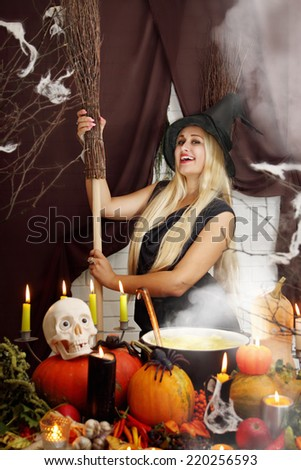 Young beautiful witch  with hat and broom