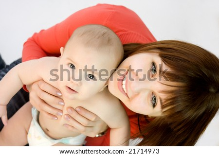 young beautiful with her baby - stock photo