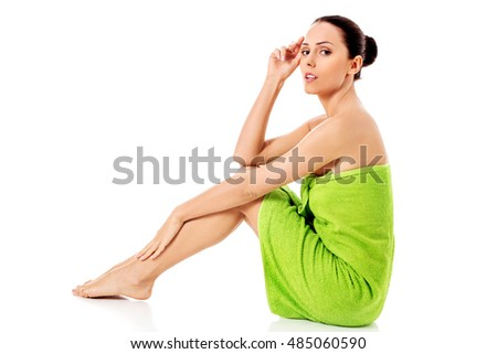 Young beautiful woman after bath full portrait isolated over white.