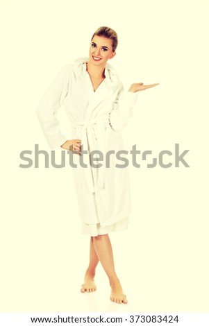 Young beautiful woman after bath shows somenthing - stock photo