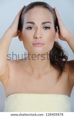 Young beautiful woman after spa treatments touch the hair and head - stock photo