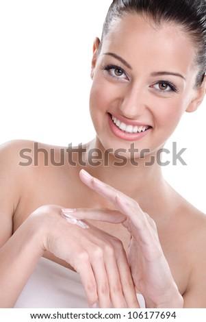 Young beautiful woman applying hands cream - stock photo
