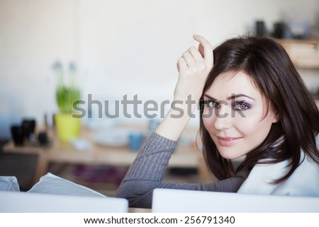 young beautiful woman at home - stock photo