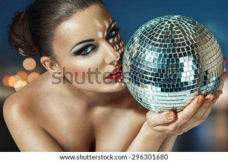 Young beautiful woman at night disco club - stock photo