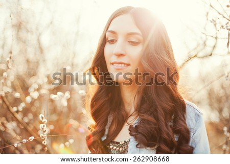young beautiful woman at sunset
