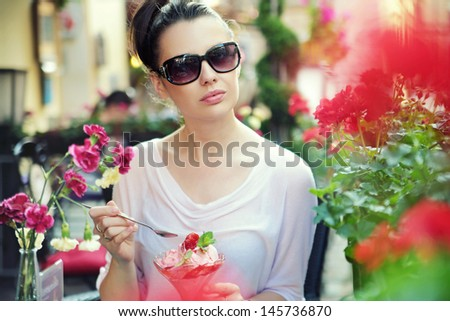 Young beautiful woman at the cafe - stock photo
