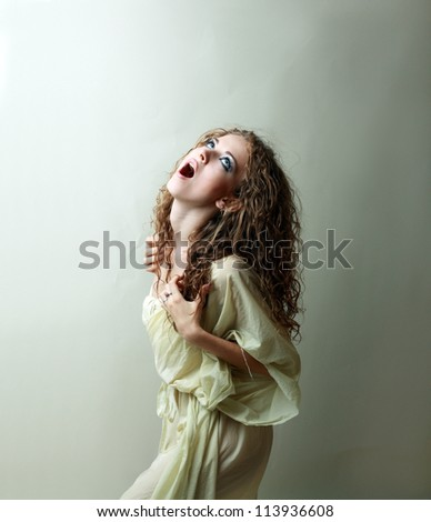 Young beautiful woman becoming zombie look scaring everybody - stock photo
