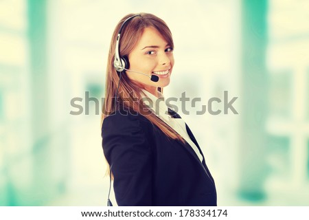 Young beautiful woman,call center worker, isolated on white background  - stock photo