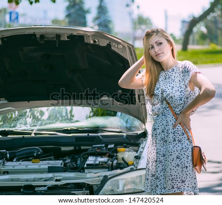 young beautiful woman car broke down - stock photo