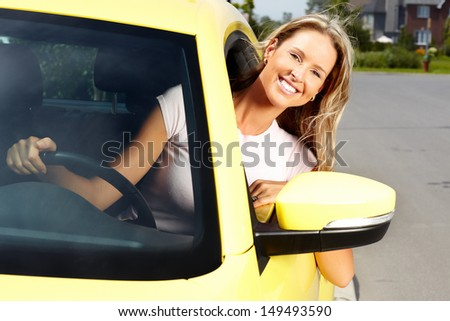 Young beautiful woman car driver in a new auto. - stock photo