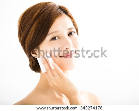 young beautiful woman cleaning face by cotton - stock photo