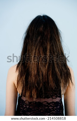Young beautiful woman combing her luxuriant hair,fashion portrait of a woman with long and curly hair - stock photo