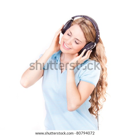 young beautiful woman dancing and listening music on with headphones isolated on white background - stock photo