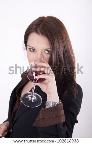 Young beautiful woman drinking glass of red wine - stock photo