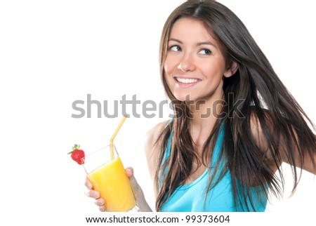 Young beautiful woman drinking orange juice cocktail with strawberry isolated on a white background - stock photo