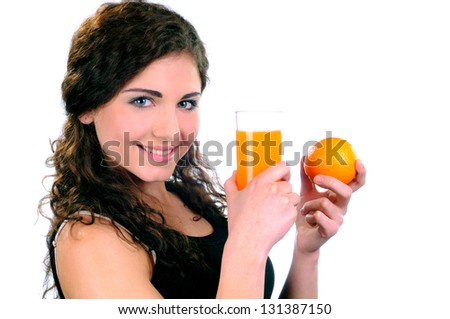 Young beautiful woman drinking orange juice isolated on a white background - stock photo