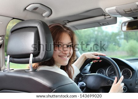 young beautiful woman driving a car