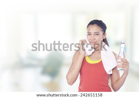 Young beautiful woman during fitness time and exercising , has gym background  - stock photo