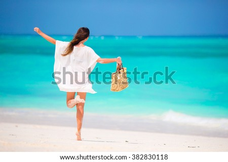 Young beautiful woman during tropical beach vacation - stock photo