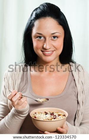 Young beautiful woman eating for breakfast cereals,Healthy meal - stock photo
