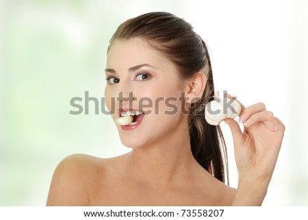 Young beautiful woman eating garlic. Healthy eating concept. Natural antibiotic that fight infection - stock photo