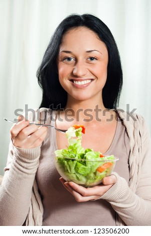Young beautiful woman eating salad,Healthy meal